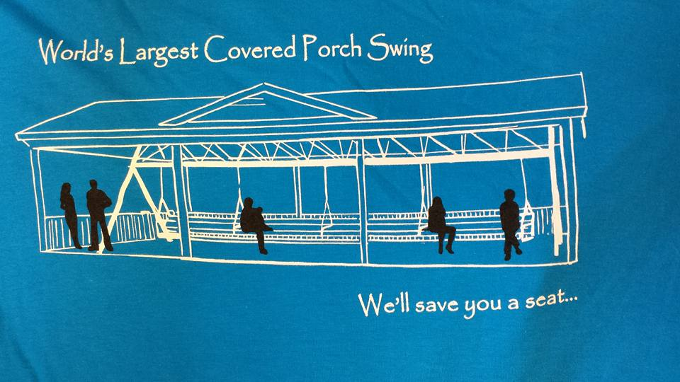 A t-shirt with a picture of a long porch swing on it.