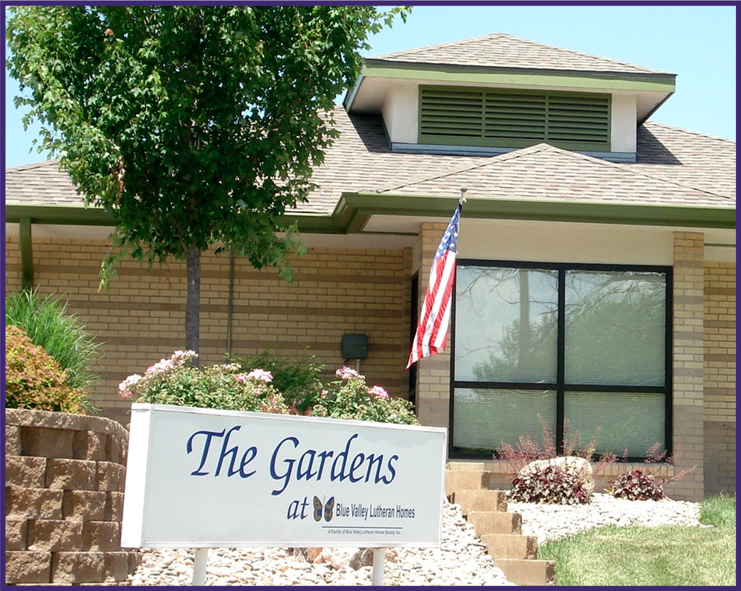 The Gardens at Blue Valley Lutheran Homes Sign with the Gardens Wing in Background