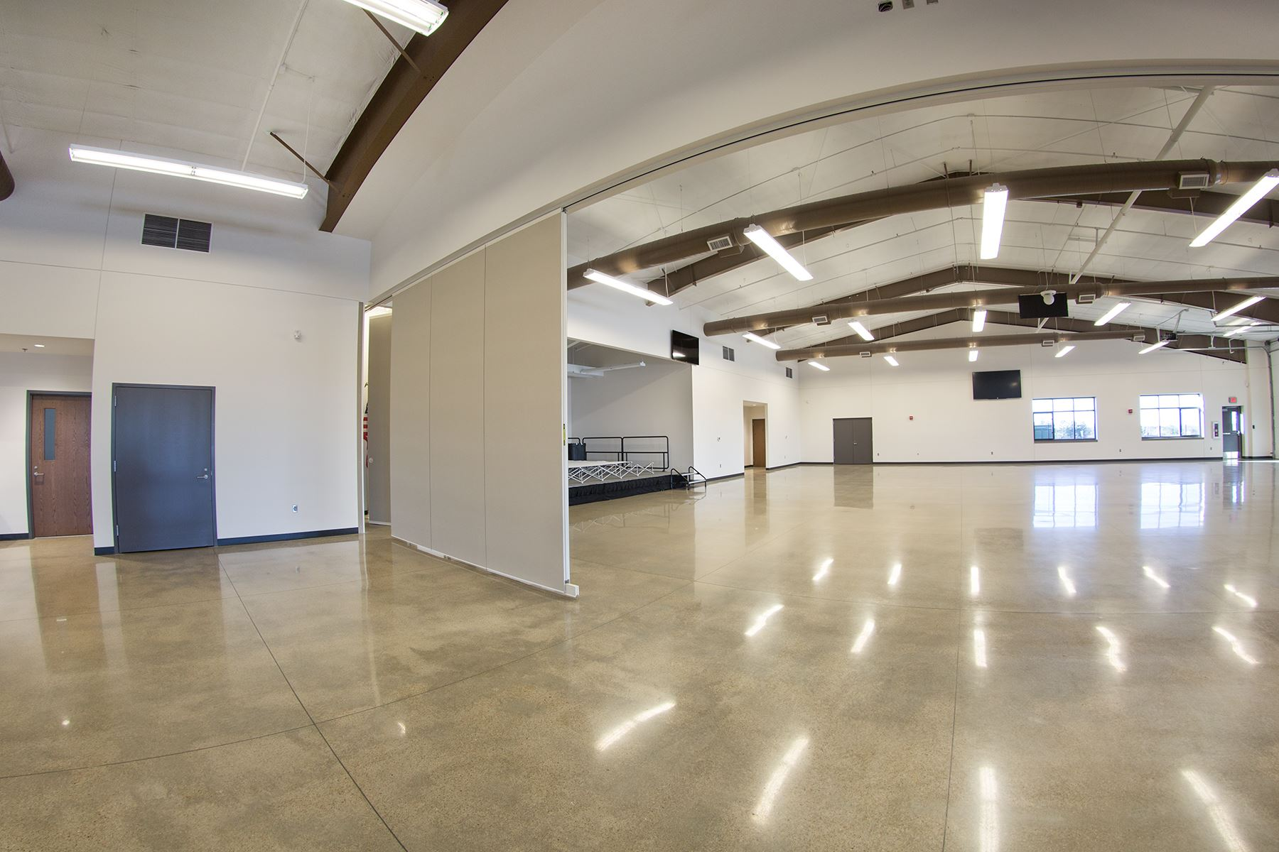 Large Room in Stastny Community Center with Florecent Lights and Room Dividers